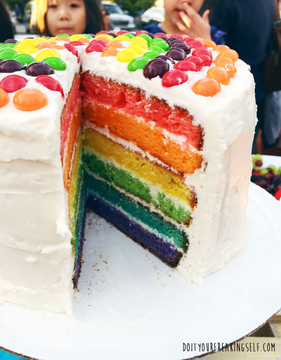 Impress your friends with a festive Rainbow layer cake! Super simple and amazing! - Doityourfreakingself.com