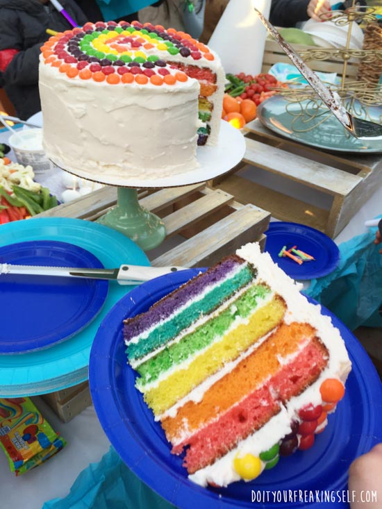Impress your friends with a festive Rainbow Surprise cake! Super simple and amazing! - Doityourfreakingself.com