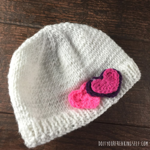 Learn how to knit a beanie with this cute tutorial! Hearts included. - doityourfreakingself.com