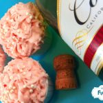 Champagne cupcakes with a fresh strawberry buttercream frosting. Doctored from a cake mix. Easy for everyone!