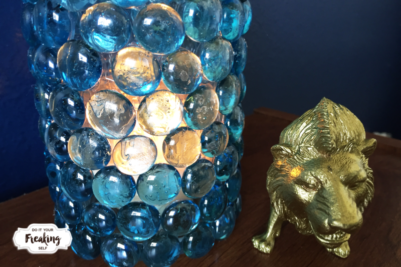 Use glass pebbles or flat marbles from the Dollar Tree to create an elegant marble vase or candle holder. A fabulous way to dress up a home for cheap.