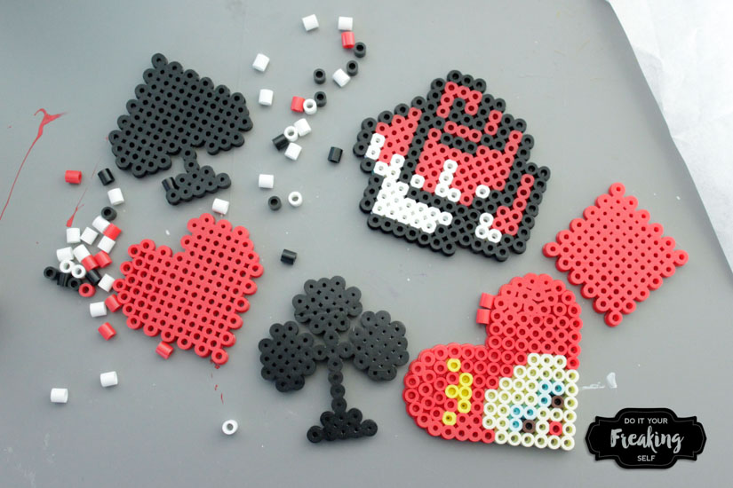 DIY Queen of Hearts Magnets inspired by Disney's Alice in Wonderland. Perler Bead patterns and ideas for your next craft project.