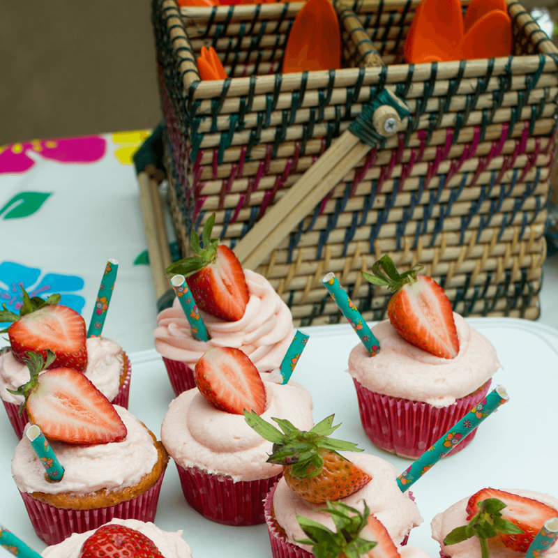 Cute Strawberry Lemonade Cupcakes are the perfect addition to a summer brunch or cook out! Tangy, sweet and easy to make! No one will know they're from a box mix!