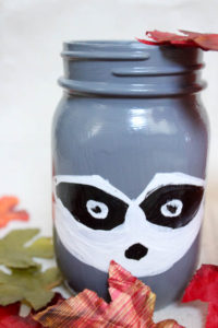 Simple DIY Fox and Raccoon Woodland Creatures painted mason jars for your kids room or fall decor!