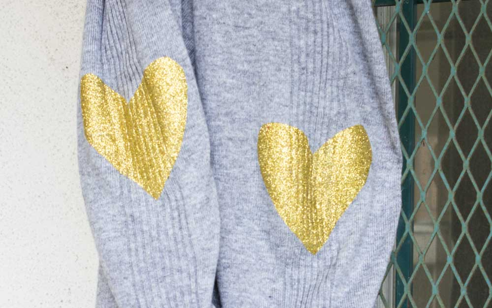 Breathe new life into an old sweater with a quick DIY Glitter Heart Elbow Patch! A fun look to brighten up boring plain sweaters! - Heart Patch Sweater | Elbow Patch | DIY Upcycle | Cardigan | Valentines - Do It Your Freaking Self