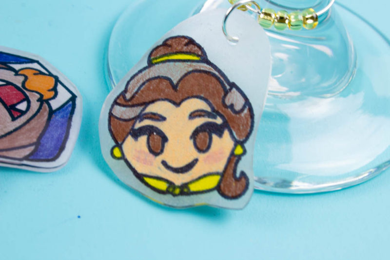 Celebrate Disney's Beauty and the Beast and add a little charm to your glass with these Disneymoji DIY Disney Wine Charms!