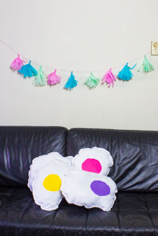 Add some comfy fun to your couch this spring with some DIY rainbow fried egg pillows! Easy sewing tutorial to make your own custom food throw pillow!
