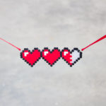 Let your geek flag fly with a DIY Legend of Zelda Pixel Heart Statment Necklace. Pull out some perler beads and your nintendo and party like it's 1986.