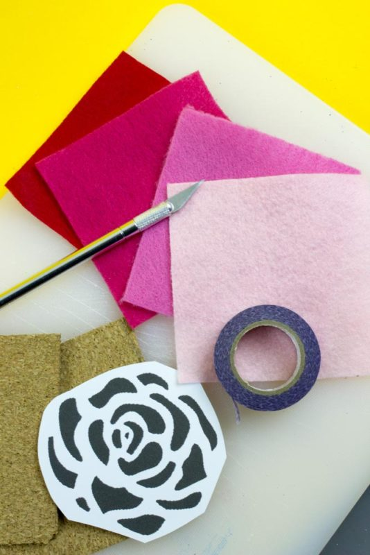 Use IKEA Avskild Placemats to create these simple rose cut out cork coasters for your next girls day or The Bachelor viewing party! - Do It Your Freaking Self - Cork Coasters   Custom Coasters   The Bachelor party   The bachelorette   Girls Day
