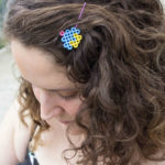 Add some fun to your hairstyle with a nostalgic twist! Learn how to turn mini cupcakes into adorable perler bead hair pins for the kid in all of us!