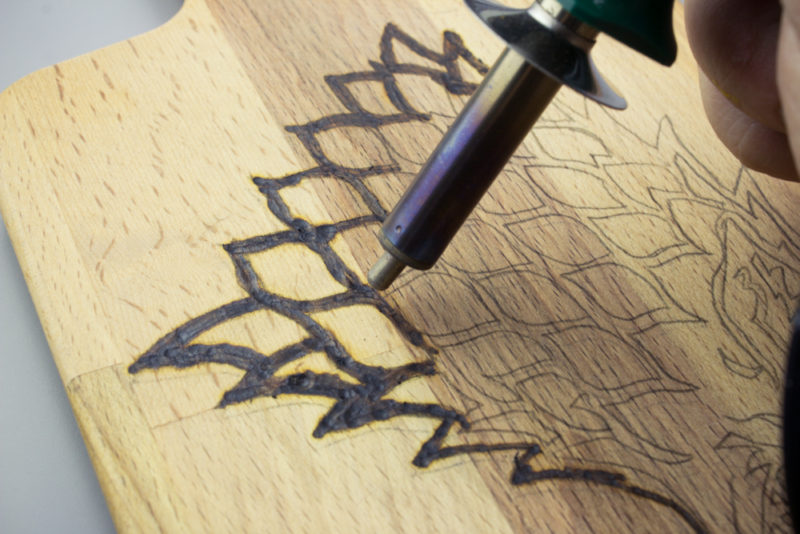 Create your own wood burned Game of Thrones Cutting Board with this easy tutorial. If you've ever wanted to try wood burning, this is a fun project to get you started!