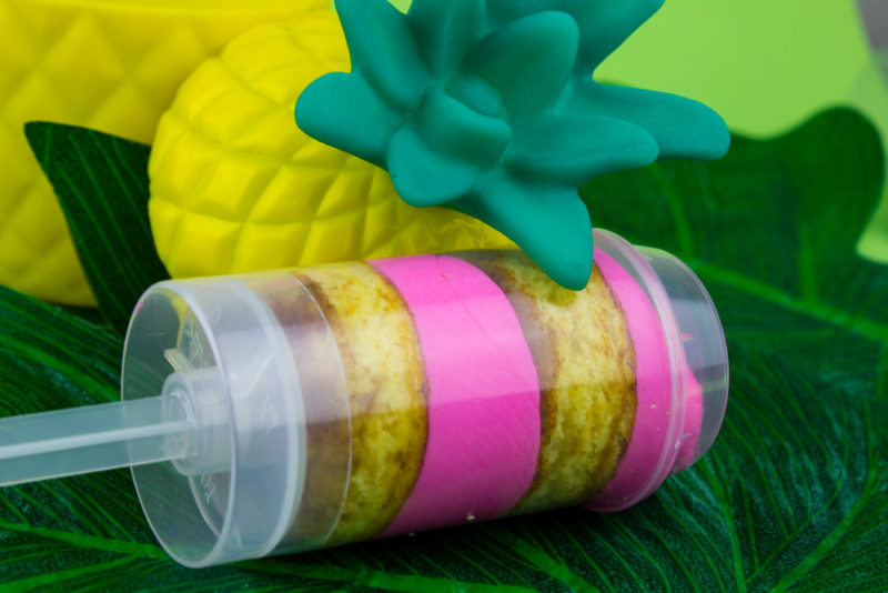 Kick off your summer luau by making these fun boozy tropical cake push pops! A sweet addition to your flamingo, pineapple, hawaiian party! Flamingo pineapple party   Luau food   treat pops   Cake pops   pink and yellow