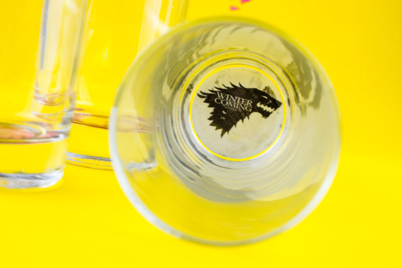 Show your Game of Thrones pride with some easy custom DIY Game of Thrones House Sigil Glasses. Represent your favorite houses and drink up!