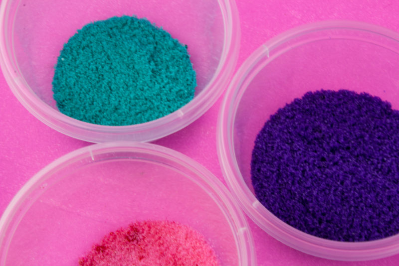 This simple way to make your own custom colored DIY sanding sugar sprinkles will blow your mind and save you money. Make custom sprinkle mixes YOUR way!