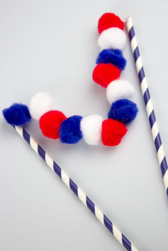 Throw some pom poms into your Independence day celebrations with this unbelievably simple DIY 4th of July Pom Pom Cake Topper.