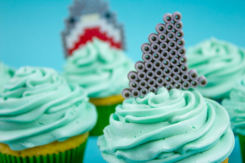 Kick off your Shark Week or Sharknado festivities with some kid friendly Perler Bead Shark Cupcake Toppers! You know you want to!