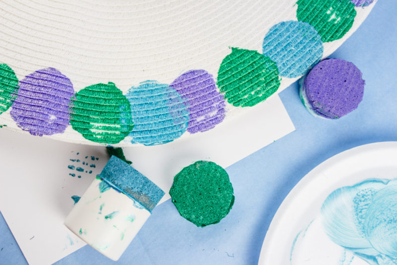 Show off your inner mermaid with a DIY Mermaid floppy hat! DIY your own custom painted floppy hat to create the perfect addition to your summer wardrobe.
