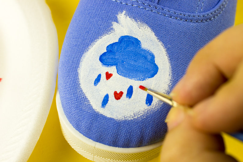 Wish on your inner child with these adorable DIY painted care bears shoes! How cute are these for kids and grown ups! - Back to school, nostalgia, vintage fashion, diy fashion, diy shoes, hand painted shoes