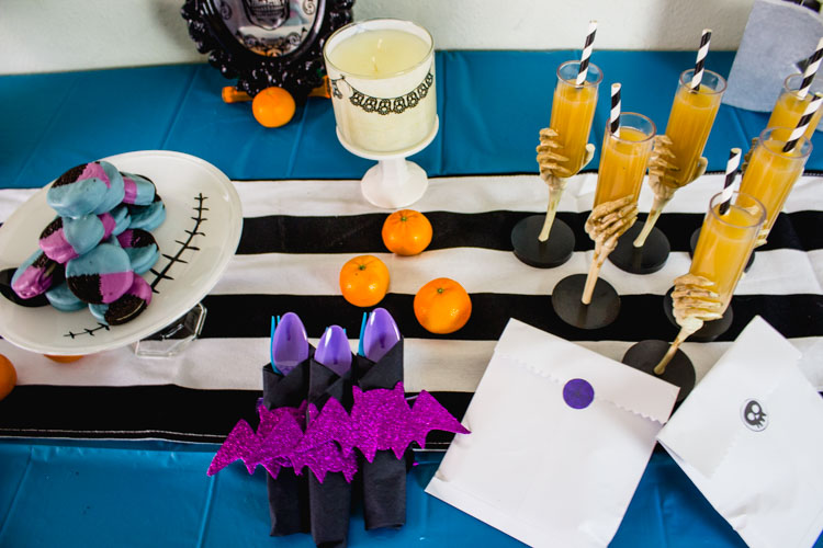 Host a Tim Burton Inspired Halloween Party! Loving the little details and pops of blue and purple that bring it together! - Doityourfreakingself.com - Halloween Tablescape, alternative halloween, nightmare before christmas, corpse bride