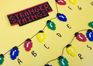 Get ready for Stranger Things Season 2 or just show off your knowledge of the Upside Down with this easy Perler Bead Stranger Things Banner. | Fusion beads | #Strangerthings | perler bead pattern | Christmas Lights | DoItYourFreakingSelf.com