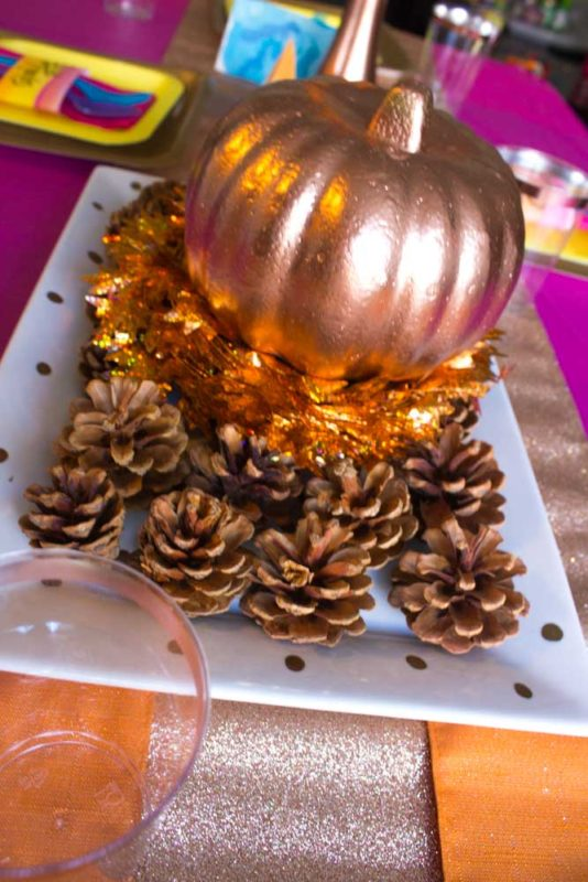Give your Friendsgiving Tablescape a vibrant pop of color with bright orange, yellow, pink and rose gold! | #friendsgiving #thanksgiving #tablescape
