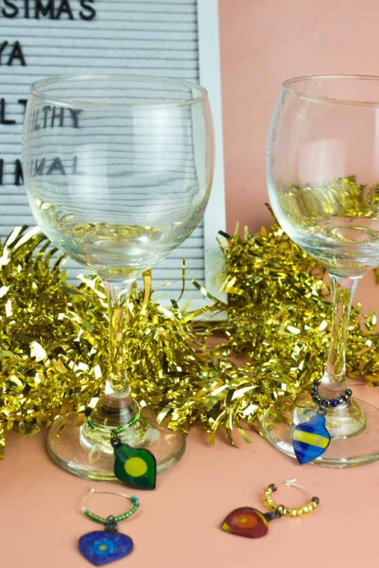Add some vintage flare to your holiday wine with these festive DIY Vintage Christmas Ornament Wine Charms! A fun project for the holidays!
