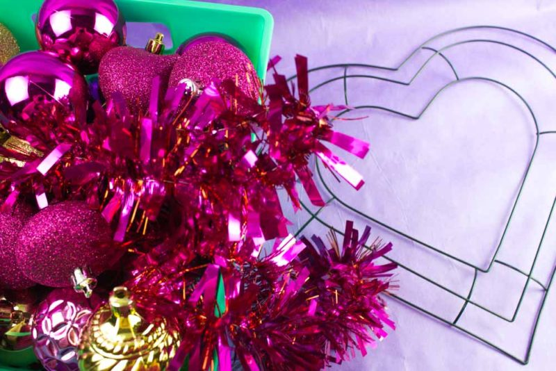 Use your left over Christmas ornaments to make this gorgeous DIY Valentines Ornament Wreath! Stay festive!  | #valentines #valentinesdecor #homedecor #diywreath | Do It Your Freaking Self