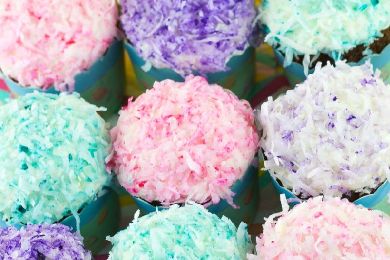 Gear up for spring with these Pastel Coconut SnoBall Cupcakes with decadent Marshmallow filling and frosting! Great for a spring table, Easter brunch or just because! | Do It Your Freaking Self | #EasterCupcakes #Coconut #Marshmallowfrosting