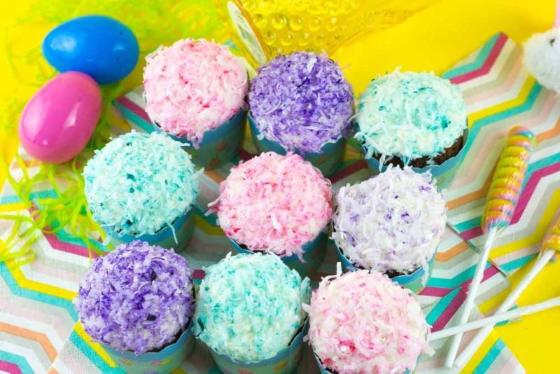 Gear up for spring with these Pastel Coconut SnoBall Cupcakes with decadent Marshmallow filling and frosting! Great for a spring table, Easter brunch or just because!   Do It Your Freaking Self   #EasterCupcakes #Coconut #Marshmallowfrosting