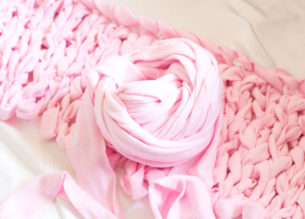 Learn how to make your own giant yarn for extreme knitting and chunky blankets! Super easy and so much cheaper that purchasing wool roving!