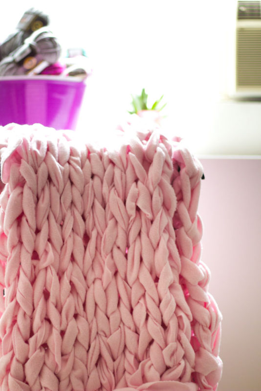 Cozy up with a giant chunky knit blanket that won't cost an arm and a leg. A great alternative to arm knitting or making your own needles too!