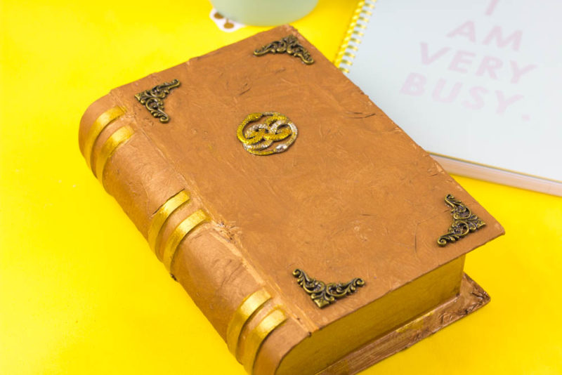 Turn up the nostalgia/nerd factor in your home with the DIY Neverending Story Book Box! Great for a remote holder! #HomeDecor #Geek #NerdHome