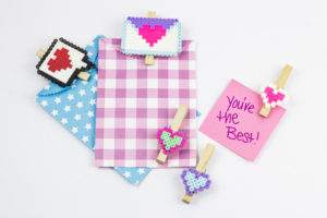 DIY Valentines Bag Clips are a fun and engaging way to add charm and festive touches to your kitchen organization efforts!| #perlerbead #pattern #valentinescrafts