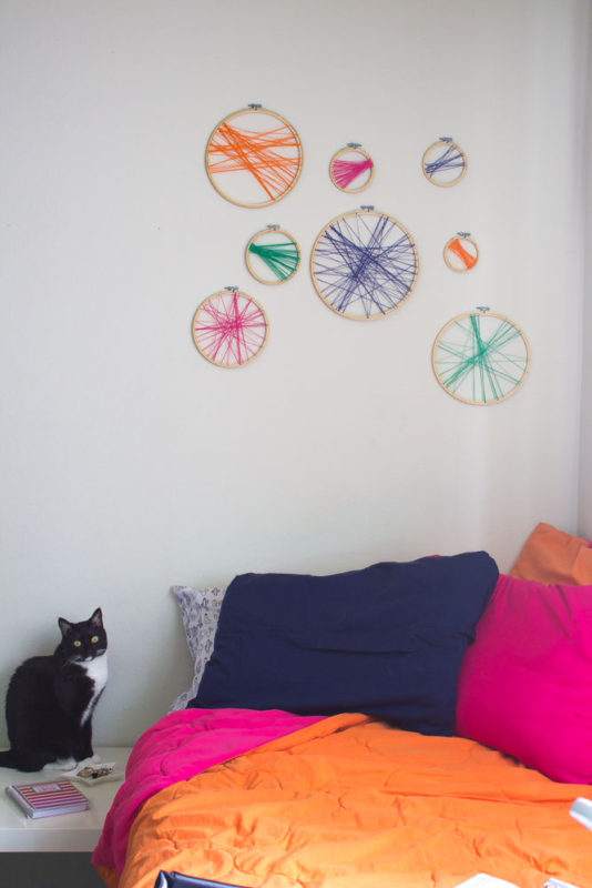 Learn how to DIY your own colorful boho headboard using embroidery hoops and your favorite colors!